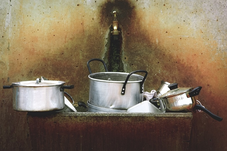 Sink full of dirty pots and pans